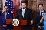 FILE - In this July 16, 2019 file photo, Puerto Rico Gov. Ricardo Rossello, accompanied by his chief of staff Ricardo Llerandi, right, attends a press conference in La Fortaleza's Tea Room, in San Juan, Puerto Rico. Llerandi announced his resignation Tuesday, July 23, 2019, saying;