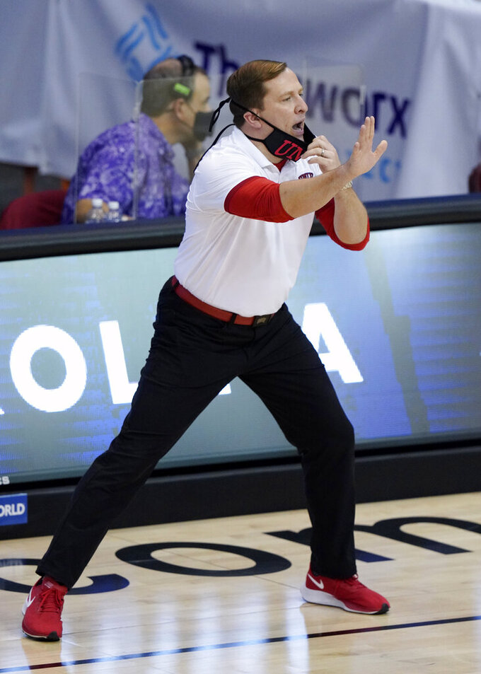 UNLV head coach T.J. Otzelberger directs his team in the first half of an NCAA college basketball game against North Carolina in the Maui Invitational tournament, Monday, Nov. 30, 2020, in Asheville, N.C. (AP Photo/Kathy Kmonicek)