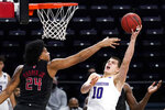 Northwestern forward Miller Kopp, right, shoots against Rutgers guard/forward Ron Harper Jr., during the second half of an NCAA college basketball game in Evanston, Ill., Sunday, Jan. 31, 2021. (AP Photo/Nam Y. Huh)