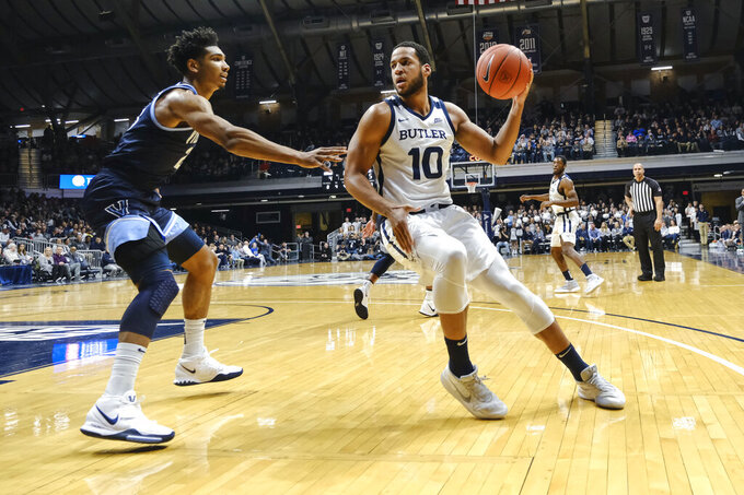 Butler forward Bryce Nze (10) looks to make a move around Villanova forward Jermaine Samuels (23) during the first half of an NCAA college basketball game in Indianapolis, Wednesday, Feb. 5, 2020. (AP Photo/AJ Mast)