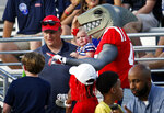 In this Sept. 8, 2018, photo, the new Mississippi mascot, a land shark, mixes with fans at Vaught-Hemingway Stadium at Mississippi, during their home opener against Southern Illinois, in Oxford, Miss. The SEC saw a drop of more than 2,400 fans per game last season, which was the biggest decline of any Power Five conference. Whether it's cheaper concessions prices, new mascots, premium seating or pricey stadium renovations, SEC schools are constantly fighting to make sure fans make their way to stadiums on Saturdays. (AP Photo/Rogelio V. Solis)