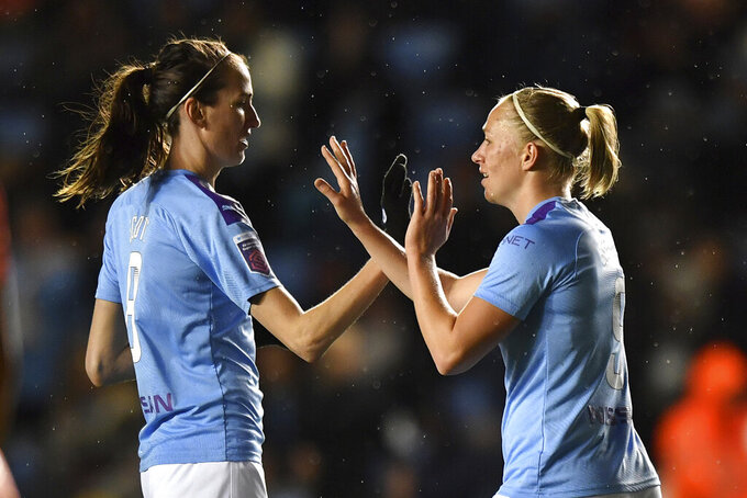 Manchester City's Pauline Bremer, right, celebrates scoring against Everton during the Women's Super League match at the Academy Stadium, Manchester, England, Saturday Jan. 11, 2020. (Anthony Devlin/PA  via AP)