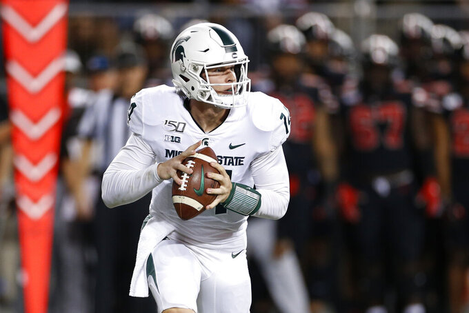 Spartans' re-tooled offense to face No. 8 Badgers' No. 1 D