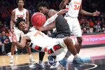 Oklahoma State forward Kalib Boone fouls Syracuse forward Quincy Guerrier (1) during the first half of an NCAA college semi final basketball game in the NIT Season Tip-Off tournament, Wednesday, Nov. 27, 2019, in New York. (AP Photo/Mary Altaffer)