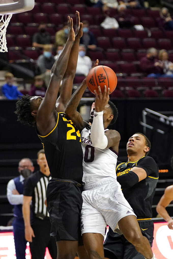 Texas A&M guard Jay Jay Chandler (0) tries to shoot over Missouri forward Kobe Brown (24) during the second half of an NCAA college basketball game Saturday, Jan. 16, 2021, in College Station, Texas. (AP Photo/Sam Craft)