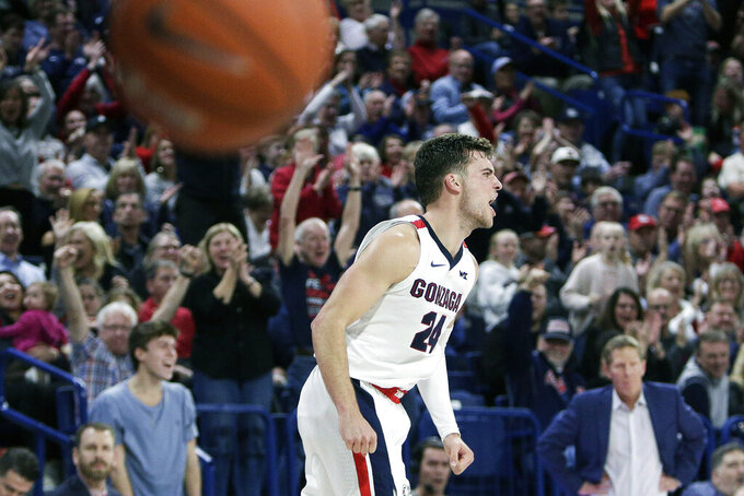 Gonzaga forward Corey Kispert (24) celebrates his dunk during the second half of an NCAA college basketball game against Alabama State in Spokane, Wash., Tuesday, Nov. 5, 2019. Gonzaga won 95-64. (AP Photo/Young Kwak)