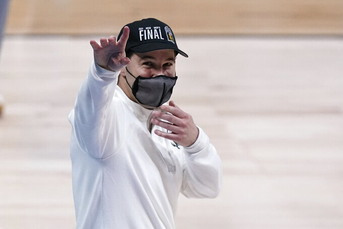 Baylor head coach Scott Drew waves to fans after an Elite 8 game against Arkansas in the NCAA men's college basketball tournament at Lucas Oil Stadium, Tuesday, March 30, 2021, in Indianapolis. Baylor won 81-72. (AP Photo/Michael Conroy)
