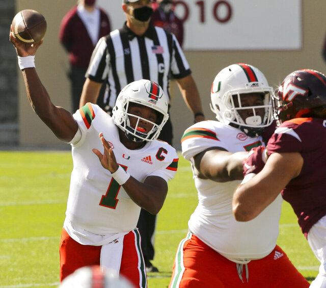 Miami quarterback D'Eriq King passes during the first half of an NCAA college football game Saturday, Nov. 14, 2020, in Blacksburg, Va. (Matt Gentry/The Roanoke Times via AP, Pool)