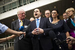 British lawmaker Alberto Costa, second left, along with a cross-party delegation of British parliamentarians talk to journalists after meeting European Union chief Brexit negotiator Michel Barnier at the European Commission headquarters in Brussels, Friday, July 19, 2019. (AP Photo/Francisco Seco)