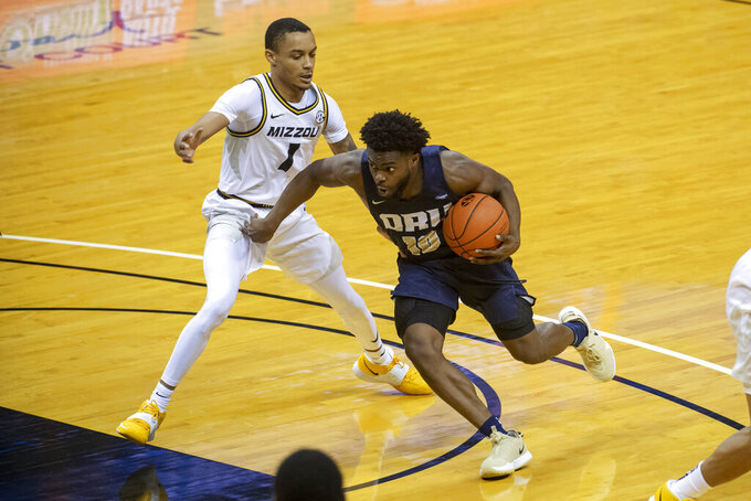Oral Roberts' RJ Glasper, right, drives past Missouri's Xavier Pinson during the first half of an NCAA college basketball game Wednesday, Nov. 25, 2020, in Columbia, Mo. (AP Photo/L.G. Patterson)
