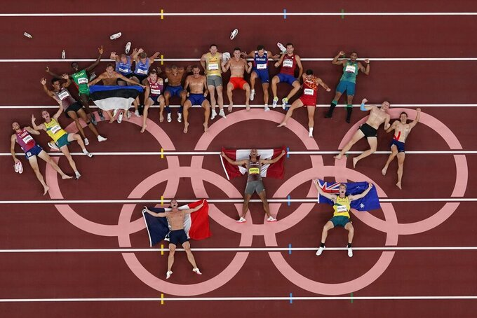 The athletes from the men's decathlon pose for a picture on the Olympic rings at the 2020 Summer Olympics, Thursday, Aug. 5, 2021, in Tokyo. (AP Photo/Morry Gash)