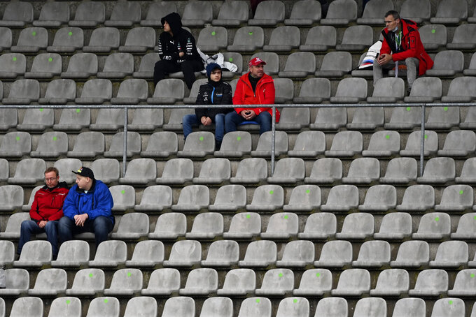 Available seats on the stands are marked to keep a distance between groups of spectators during the first practice session for the Eifel Formula One Grand Prix at the Nuerburgring racetrack in Nuerburg, Germany, Friday, Oct. 9, 2020. The Germany F1 Grand Prix will be held on Sunday. (Ina Fassbender, Pool via AP)