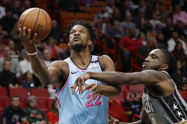 Miami Heat forward Jimmy Butler (22) goes up for a shot against Brooklyn Nets forward Taurean Prince (2) during the first half of an NBA basketball game, Saturday, Feb. 29, 2020, in Miami. (AP Photo/Wilfredo Lee)