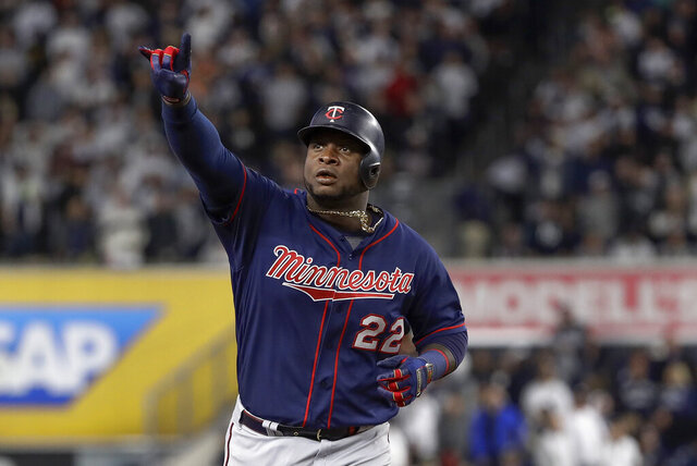 FILE - In this Oct. 4, 2019, file photo, Minnesota Twins' Miguel Sano rounds the bases after hitting a solo home run against the New York Yankees during the sixth inning of Game 1 of an American League Division Series baseball game in New York. Sano and the Twins avoided arbitration by agreeing to a $30 million, three-year contract on Friday, Jan. 10, a person familiar with the deal told The Associated Press. The person spoke on condition of anonymity because the agreement had not been announced. (AP Photo/Frank Franklin II, File)