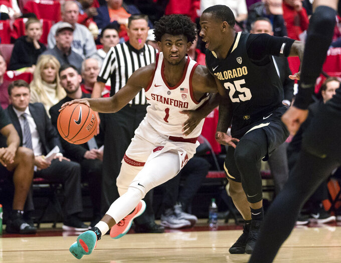 Stanford guard Daejon Davis (1) dribbles as Colorado guard McKinley Wright IV (25) defends during the first half of an NCAA college basketball game in Stanford, Calif., Saturday, Jan. 26, 2019. (AP Photo/John Hefti)
