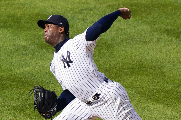 New York Yankees relief pitcher Aroldis Chapman winds up during the ninth inning of a baseball game against the Baltimore Orioles, Sunday, Sept. 13, 2020, at Yankee Stadium in New York. Chapman earned a save in the Yankees victory over the Baltimore Orioles. (AP Photo/Kathy Willens)