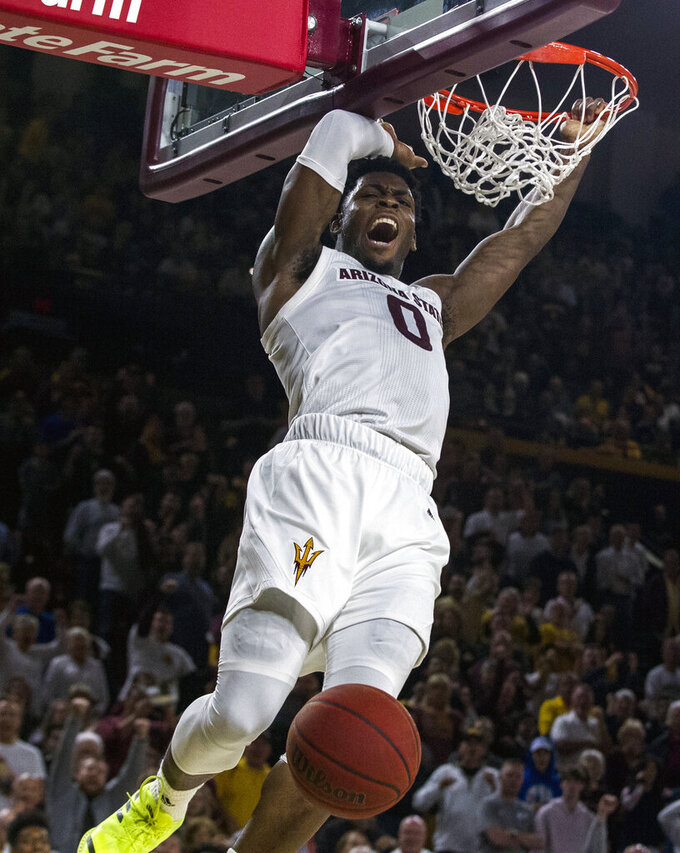 FILE - In this Jan. 19, 2019, file photo, Arizona State's Luguentz Dort (0) dunks against Oregon during the second half of an NCAA college basketball game, in Tempe, Ariz. Dort was named Newcomer of the Year in the Pac-12, Tuesday, March 12, 2019. (AP Photo/Darryl Webb, File)