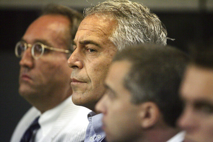 FILE - In this July 30, 2008, file photo, Jeffrey Epstein, center, appears in court in West Palm Beach, Fla.  Newly released court documents show that Epstein repeatedly declined to answer questions about sex abuse as part of a lawsuit. A partial transcript of the September 2016 deposition was included in hundreds of pages of documents placed in a public file Friday, Aug. 9, 2019 by a federal appeals court in New York. Epstein has pleaded not guilty to sex trafficking charges after his July 6 arrest.  (Uma Sanghvi/Palm Beach Post via AP, File)