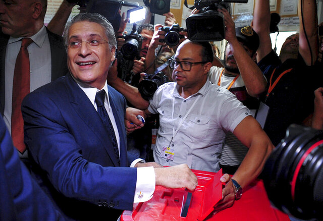 FILE - In this Sunday, Oct. 13, 2019 file photo, Tunisian media mogul Nabil Karoui casts his ballot at a polling station during the second round of the presidential election, in Tunis, Tunisia. Former Tunisian presidential candidate and media mogul Nabil Karoui was arrested Thursday, Dec. 24 on charges of money laundering and tax evasion. (AP Photo/Hassene Dridi, File)