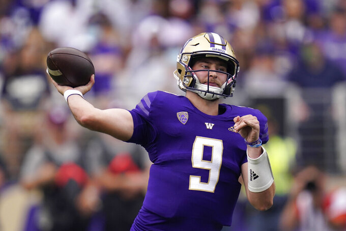 Washington quarterback Dylan Morris drops back to pass against Montana in the first half of an NCAA college football game Saturday, Sept. 4, 2021, in Seattle. (AP Photo/Elaine Thompson)