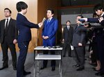 Japan's Prime Minister Shinzo Abe speaks to media about the projectile that North Korea launched Thursday, Nov. 28, 2019, in Tokyo. (Kyodo News via AP)