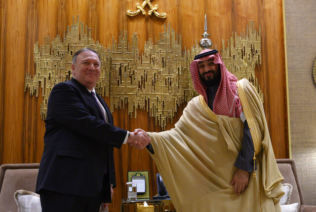 U.S. Secretary of State Mike Pompeo, left, shakes hands with Saudi Arabia's Crown Prince Mohammed bin Salman at Irqah Palace, in the capital Riyadh Saudi Arabia, Thursday, February 20, 2020. Pompeo met with King Salman in the capital, Riyadh, on Thursday. (Andrew Caballero-Reynolds/Pool via AP)