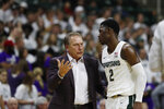 Michigan State head coach Tom Izzo talks with guard Rocket Watts Jr. (2) during the first half of an NCAA college exhibition basketball game against Albion, Tuesday, Oct. 29, 2019, in East Lansing, Mich. (AP Photo/Carlos Osorio)