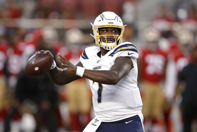 Los Angeles Chargers quarterback Cardale Jones (7) looks for a receiver during the first half of the team's NFL football preseason game against the San Francisco 49ers in Santa Clara, Calif., Thursday, Aug. 29, 2019. (AP Photo/Ben Margot)