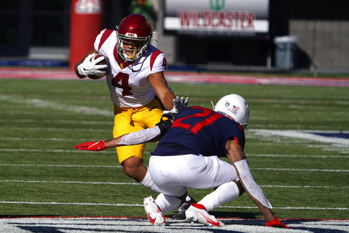 Southern California wide receiver Bru McCoy (4) stiff-arms Arizona defensive back Jaxen Turner (21) in the first half during an NCAA college football game, Saturday, Nov. 14, 2020, in Tucson, Ariz. (AP Photo/Rick Scuteri)