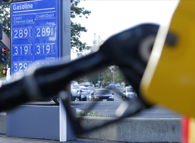 FILE - In this Oct. 30, 2017, file photo, gasoline prices are displayed at a Chevron station in Sacramento, Calif. The average U.S. price of regular-grade gasoline dropped 7 cents per gallon to $2.53 over the past two weeks. Industry analyst Trilby Lundberg of the Lundberg Survey said Sunday, Feb. 9, 2020, that gas prices responded to falling crude oil costs. The price at the pump is 19 cents higher than it was a year ago. The highest average price in the nation for regular-grade gas is $3.54 per gallon in the San Francisco Bay Area. (AP Photo/Rich Pedroncelli, File)
