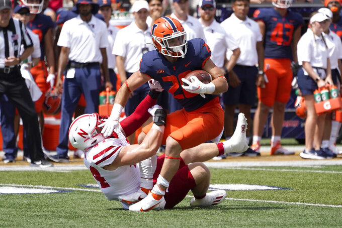 Nebraska linebacker Garrett Nelson tackles Illinois running back Mike Epstein for a loss during the first half of an NCAA college football game Saturday, Aug. 28, 2021, in Champaign , Ill. (AP Photo/Charles Rex Arbogast)