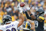 Pittsburgh Steelers defensive back Kam Kelly (29) makes an interception in front of Baltimore Ravens tight end Mark Andrews (89) in the first half of an NFL football game, Sunday, Oct. 6, 2019, in Pittsburgh. (AP Photo/Don Wright)