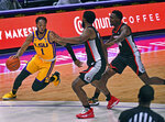 LSU guard Javonte Smart (1) drives to the basket past Georgia forward Andrew Garcia and guard Tye Fagan (14) during the first half of an NCAA college basketball game Wednesday, Jan. 6, 2021, in Baton Rouge, La. (Hilary Scheinuk/The Advocate via AP)