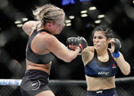 Rachael Ostovich, right, punches Paige VanZant during the first round of a women's flyweight mixed martial arts bout at UFC Fight Night Saturday, Jan. 19, 2019, in New York. VanZant stopped Ostovich in the second round. (AP Photo/Frank Franklin II)