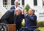 Gov. Greg Abbott presents the Governor's Medal of Courage on Monday morning Jan. 13, 2020 to Jack Wilson, who shot and killed 43-year-old gunman Keith Thomas who opened fire on the congregation and killed two people at West Freeway Church of Christ in White Settlement, Texas on December 29, 2019. The Governor's Medal of Courage is given to civilians who display great acts of heroism by risking their own safety to save another's life. It is the highest award given to civilians by the Governor. (Ricardo B. Brazziell/Austin American-Statesman via AP)