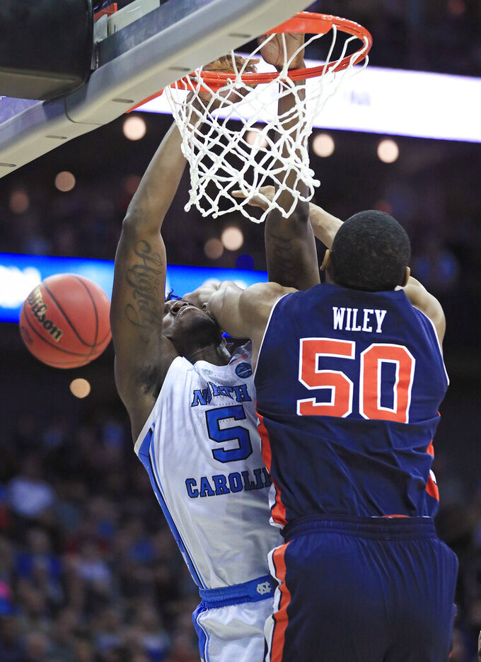 Auburn's Austin Wiley (50) knocks the ball away from North Carolina's Nassir Little (5) during the second half of a men's NCAA tournament college basketball Midwest Regional semifinal game Friday, March 29, 2019, in Kansas City, Mo. (AP Photo/Orlin Wagner)