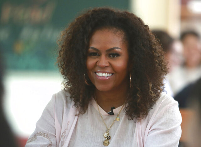 FILE - In this Dec. 9, 2019, file photo, former first lady Michelle Obama listens to female students at the Can Giuoc high school in Long An province, Vietnam. Seeking to unite Democrats, Joe Biden has raced to line up supporters ranging from progressive icon Bernie Sanders to former President Barack Obama, whose administration sometimes irked liberals. But the person with the most influence may be Michelle Obama. (AP Photo/Hau Dinh, File)