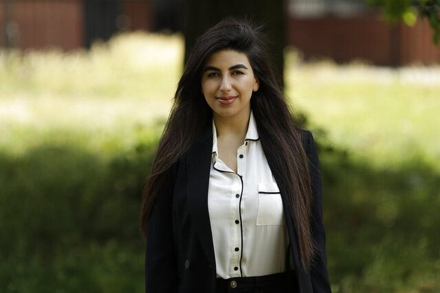 In this photo taken on Thursday, June 11, 2020, recent university graduate Sahar Shabani poses for a photograph in London. The global coronavirus crisis, which has already thrown much of the business world into turmoil, is also disrupting summer internships, which are an important stepping stone to working life for many university students and recent graduates and a recruiting pipeline for companies. Recent graduate Sahar Shabani, 22, did a three-month remote internship with a development charity based in Thailand from her parents' home in South London. (AP Photo/Matt Dunham)