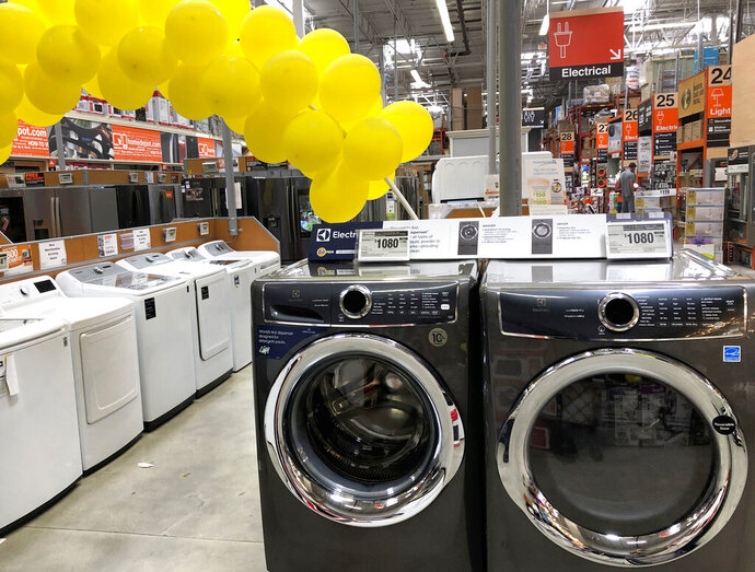 In this Tuesday, April 23, 2019 photo, clothes washers and dryers are shown for sale at a Home Depot store in Miami Lakes, Fla. On Thursday, April 25, the Commerce Department releases its March report on durable goods. (AP Photo/Wilfredo Lee)
