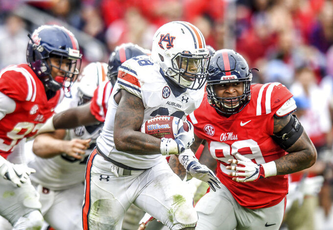 Auburn running back JaTarvious Whitlow (28) runs against Mississippi during an NCAA college football game at Vaught-Hemingway Stadium in Oxford, Miss., Saturday, Oct. 20, 2018. (Bruce Newman/The Oxford Eagle via AP)