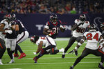 Houston Texans running back David Johnson (31) runs for a gain against the Tampa Bay Buccaneers during the first half of an NFL preseason football game Saturday, Aug. 28, 2021, in Houston. (AP Photo/Justin Rex)