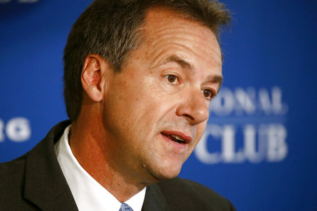 FILE - In this Aug. 7, 2019 file photo, Democratic Montana Gov. Steve Bullock speaks at the National Press Club in Washington. Bullock said Monday, March 9, 2020, he will run against first-term Republican Sen. Steve Daines, giving Democrats a boost in their effort to take control of the Senate in November. (AP Photo/Patrick Semansky, File)