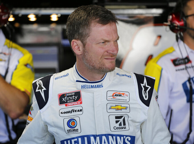 Dale Earnhardt Jr. looks on in the garage before practice for NASCAR auto race on Friday, Aug. 30, 2019, in Darlington, S.C.. (AP Photo/Terry Renna)