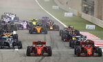 Ferrari driver Charles Leclerc of Monaco, front right, and Ferrari driver Sebastian Vettel of Germany, front center, steer their cars during the Baharain Formula One Grand Prix at the Bahrain International Circuit in Sakhir, Bahrain, Sunday, March 31, 2019. (AP Photo/Hassan Ammar)