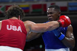 Richard Torrez Jr., from the United States, left, exchanges punches with Cuba's Dainier Pero during their men's super heavyweight over 91-kg boxing match at the 2020 Summer Olympics, Sunday, Aug. 1, 2021, in Tokyo, Japan. (AP Photo/Themba Hadebe, Pool)