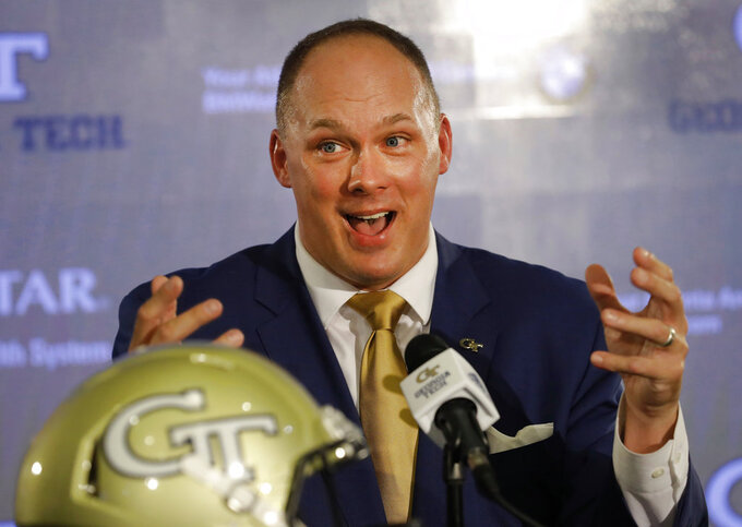 FILE - In this Dec. 7, 2018, file photo, newly hired Georgia Tech NCAA college football coach Geoff Collins speaks during a news conference in Atlanta. Collins' first signing class at Georgia Tech includes two who initially committed to other schools. Collins had 15 signees on Wednesday's, Dec. 19, 2018, first day of the early signing period, less than two weeks after being named Georgia Tech's coach. (AP Photo/John Bazemore, File)