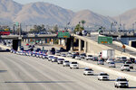 A procession of law enforcement, led by the San Bernardino County Sheriff, escort the body of San Bernardino County Sheriff's Sgt. Dominic Vaca, traveling north on the 215 Freeway through San Bernardino, on its way to his memorial service at the Glen Helen Amphitheater in San Bernardino, Calif., Friday, June 11, 2021. Sgt. A Southern California sheriff's sergeant who was shot and killed last week after an attempted traffic stop was memorialized Friday as a consummate professional and inspiring leader. (Watchara Phomicinda/The Orange County Register via AP)