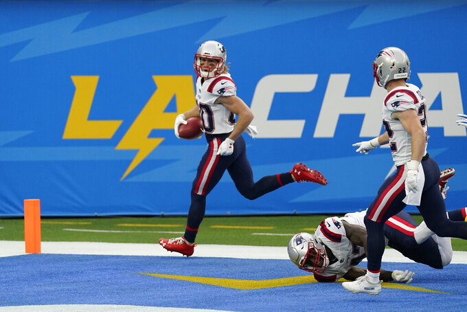 New England Patriots wide receiver Gunner Olszewski returns a punt for a touchdown during the first half of an NFL football game against the Los Angeles Chargers Sunday, Dec. 6, 2020, in Inglewood, Calif. (AP Photo/Ashley Landis)