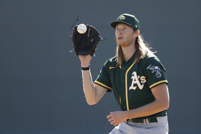 Oakland Athletics' A.J. Puk runs a drill during spring training baseball practice, Thursday, Feb. 13, 2020, in Mesa, Ariz. (AP Photo/Darron Cummings)