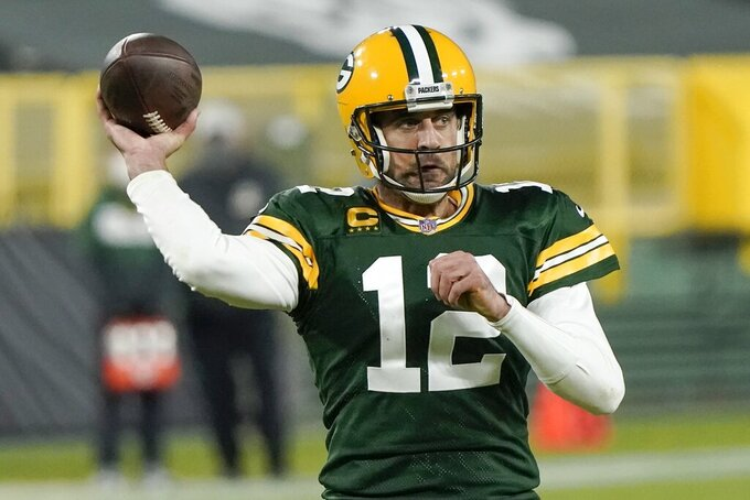 Green Bay Packers' Aaron Rodgers throws a touchdown pass during the second half of an NFL football game against the Philadelphia Eagles Sunday, Dec. 6, 2020, in Green Bay, Wis. (AP Photo/Morry Gash)